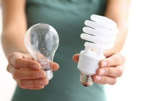 old incandescence light bulb next to a new LED energy saving light bulb