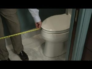 yankee home improvement contractor measuring bathroom for new Bath installation
